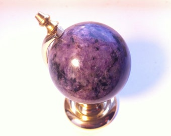 Globe souvenir from the Russian stone charoite