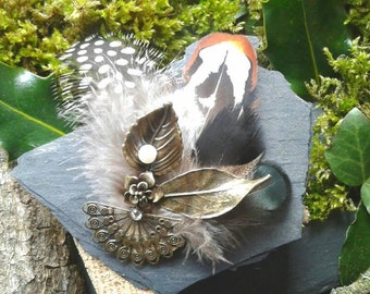 PIN bronze nature and feathers