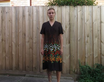 Kitschy brown 70s dress with bright floral pattern