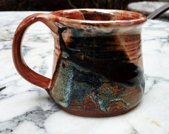 stoneware pottery mug handmade blue and tan and rusty red