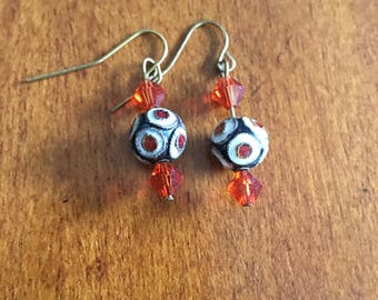 Bead and cyrstal earrings with a playful design.