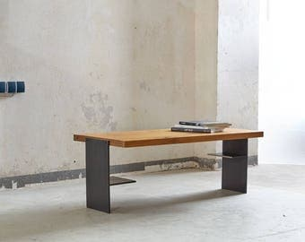 Raw steel cheeks and rustic oak coffee table