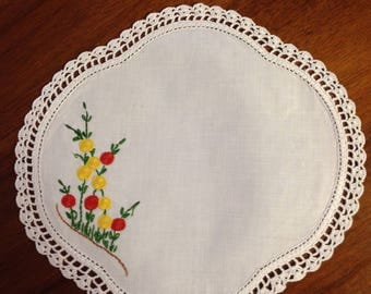 Vintage hand embroidered round scalloped doily, 22 cm, red and yellow hollyhocks
