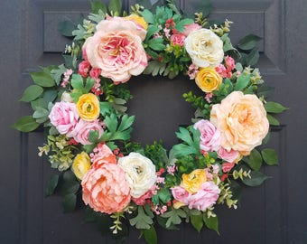 Spring/summer floral wreath with variety of flowers and greens