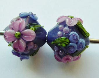 Glass lampwork beads in purple with floral decoration