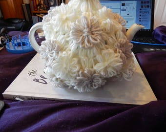 Tea Cosy Made of Beige and White Wool Flowers