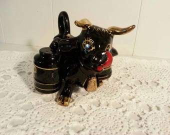 Black cow with saddle bags salt and pepper shaker 1950s