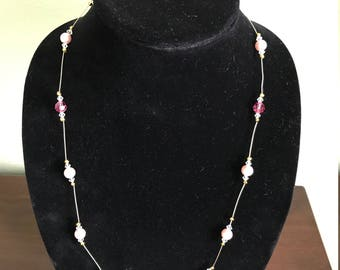 A sngle-strand 70 cm (27.55 inches) long pink illusion necklace