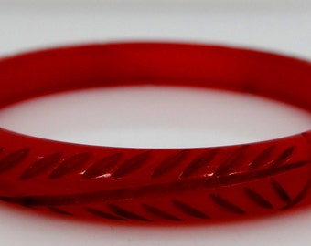 Carved Red Bakelite Child's Bangle Bracelet