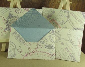 4 mini A7 Handmade envelopes in cream with postmarks, coloured inside