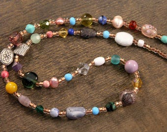 Freshwater pearl, fluorite, labradorite, swarovski crystal, fossilized dinosaur bone, stone, glass necklace