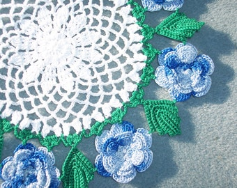 handmade round crochet doily with shaded blue roses --  1673