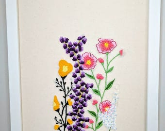 Embroidered floral scene. Flower embroidery. Embroidered art.