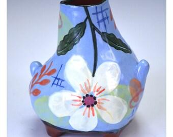 Blue bottle, white flower,