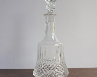Vintage crystal decanter with finial topper