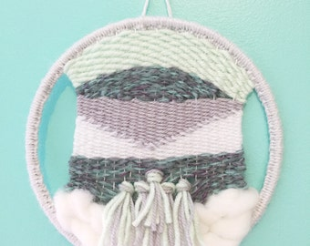 Blue, gray, and white circle weaving