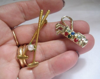 2 Figural Pins GOLF One Gold Bag and One with Clubs and a Ball