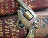 Vintage Revolver pistol charm with moving barrel tiny metal charm cute as a button