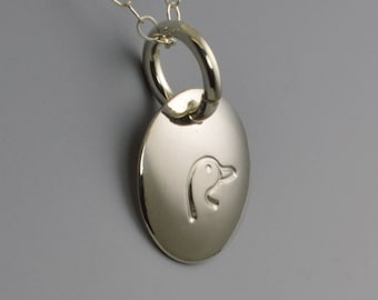 Duck Stamped Sterling Silver Pendant