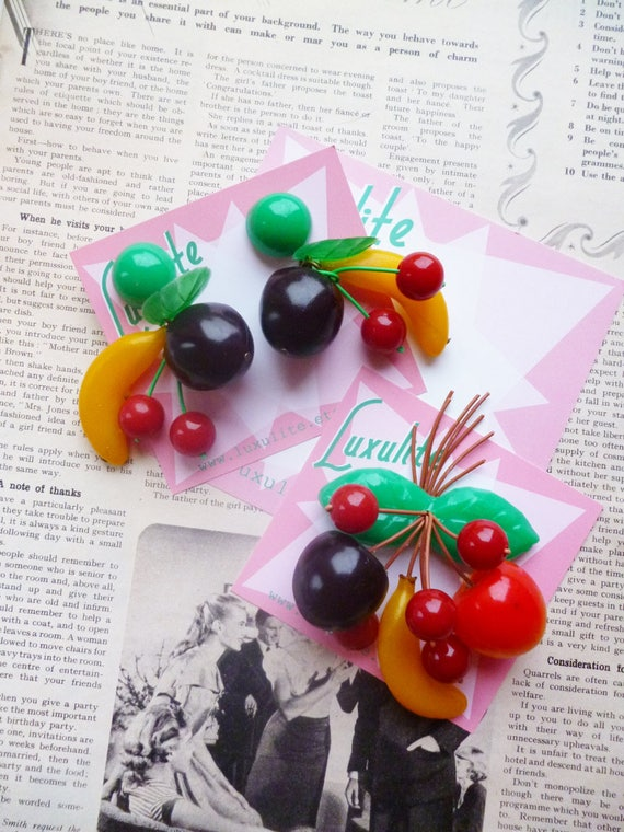 New 1940s Costume Jewelry: Necklaces, Earrings, Pins Tutti Fruity fruit salad! Handmade 40s 50s Bakelite fakelite style novelty fruit salad brooch and earrings by Luxulite $22.00 AT vintagedancer.com