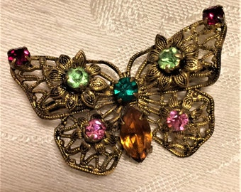 Vintage Filigree Rhinestone Butterfly Brooch with Red, Green, Pink, and Red Rhinestones. It's 1 1/2 Inches Wide and About an Inch Tall (D12)