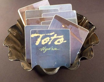 Toto heirloom quality wood coasters with warped record bowl created from recycled Hydra music album
