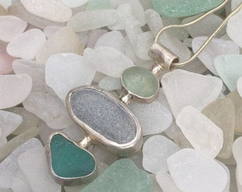 """Handmade in NH, ocean tumbled light green and aqua seaglass and a gray beach stone bezel set in sterling silver """"LOW TIDE"""" necklace"""