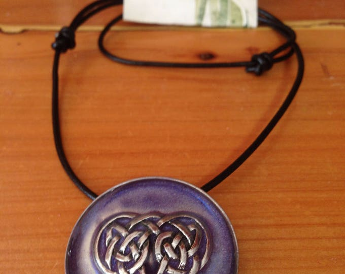 Celtic heart with purple background on leather necklace. Handmade in Australia. Pewter and Resin