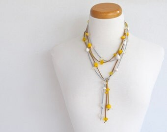 Lariat necklace. Double strand White resin on silver suede Yellow resin on gold suede.