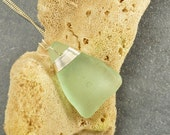 Luminous sea foam pale green Maine sea / beach glass necklace / pendant simply lashed with sterling silver