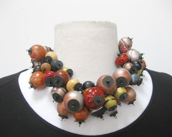 Clustered beaded necklace-short-ALL hand painted wood beads- brown tones with silver and mustard colors. Choker style-18 inches.