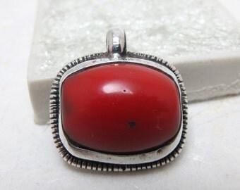 Tibetan Silver Repoussé And Red Copal Pendant