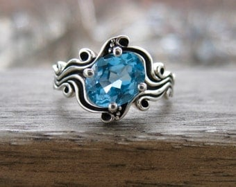 Light Blue Topaz Engagement Ring in Sterling Silver with Ocean Sea Surf Theme and Blackened Waves or Grooves Size 8