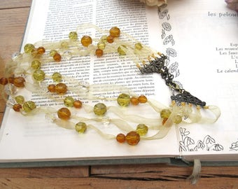 Fantastiques Cabrioles: necklace with quartz faceted beads on organza !!!!!