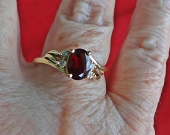 20% off sale Vintage gold tone  size 9.5  ring with garnet center rhinestone and clear rhinestones in great condition