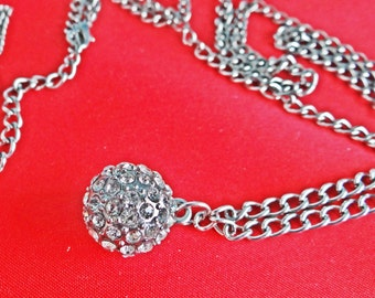 """Vintage silver  tone  30"""" necklace with attached rhinestone .75"""" ball pendant in great condition"""