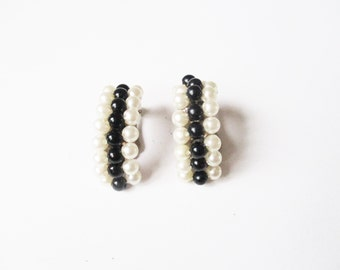 Costume pearl earrings: High luxe black lucite and faux pearl mid-century costume clip on earrings, silver tone settings, half hoop style