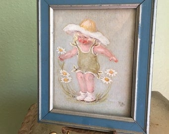 Sweet pastel of little girl and daisys