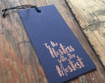 WT-304 Hostess with the Mostess wine tag foil