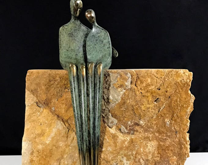 "Bronze figures 20"" cradled sitting pair of lovers. He has his arm around her."