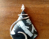 Chinese writing stone and sterling silver wire wrapped pendant. Simple design.