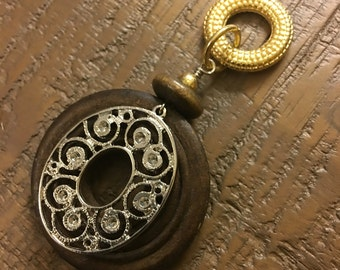 Jewelry pendant in wood with gold and silver metal