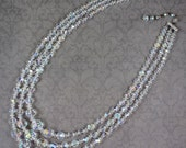 Vintage 1950s to 1960s Triple Strand Clear Crystal AB Graduated Triple Strand Beaded Necklace
