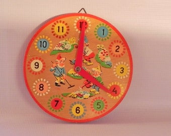 Vintage Wood Clock Toy. Children Kids Time Teaching. Learning to Tell Time. Numbers and Elves in Bright Colors.