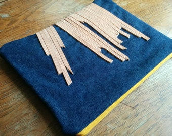 Denim clutch with decorative reclaimed leather strips, yellow zipper , one-of-a-kind