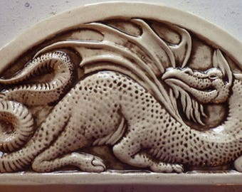 Handmade relief carved ceramic dragon hanging