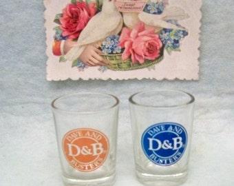 D & B ~ Dave And  Busters Shot Glasses ~ 2 Jigger Glasses 1 Orange 1 Blue
