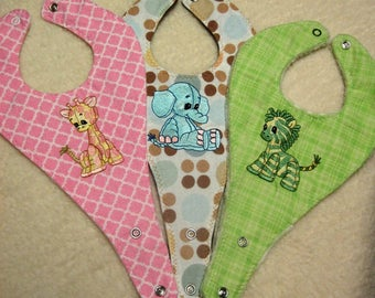 Your choice one or all of adorable embroidered baby stuffed animal pacifier bibs, 3 ply bibs, baby bibs
