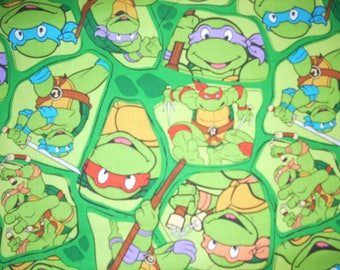 "Teenage Mutant Ninja Turtles on green -  Cotton Fabric  - 15"" wide by 23 "" long"