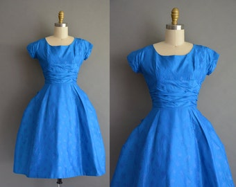 vintage 50s royal blue party dress with embossed bow details throughout. vintage 1950s dress